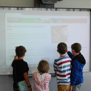 <div class='photo-title'>And this is what it's all about...</div><div class='photo-desc'>Young archaeologists enjoyed trying out the new website on an interactive whiteboard</div>