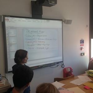 <div class='photo-title'></div><div class='photo-desc'>The Falcons design team with their presentation</div>