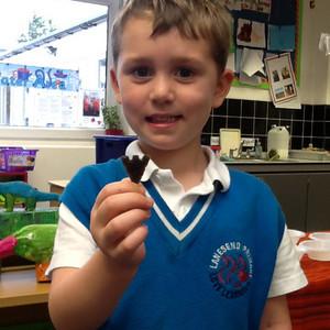 <div class='photo-title'>Matthew and his arrowhead</div>