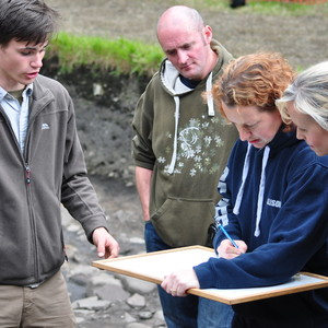 <div class='photo-title'>Nathan explains how to draw a plan with the grown-ups</div><div class='photo-desc'></div>