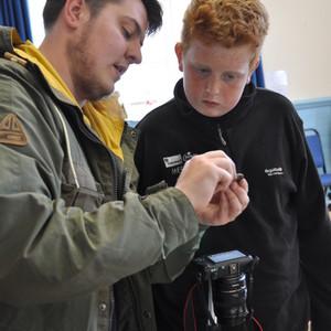 <div class='photo-title'>Dan examines a Roman coin...</div><div class='photo-desc'></div>