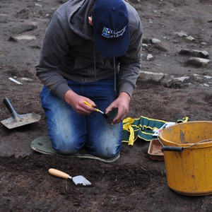 <div class='photo-title'>Jack uses a brush to clean off a find</div><div class='photo-desc'></div>