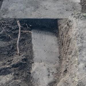 <div class='photo-title'>The reward for an afternoon of hard work</div><div class='photo-desc'>A hidden gravestone begins to emerge!</div>
