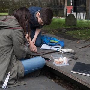 <div class='photo-title'>Alexander and Charlotte examining the human bones</div><div class='photo-desc'></div>