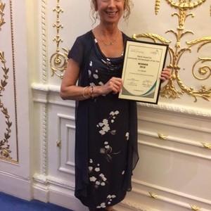 <div class='photo-title'>Liz and her Award</div><div class='photo-desc'></div>
