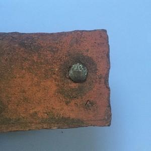 <div class='photo-title'>A Roman roof tile with nail</div><div class='photo-desc'></div>