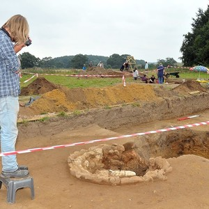<div class='photo-title'>Photographing the excavated kiln</div><div class='photo-desc'>Photo courtesy of the Aylsham Roman Project</div>