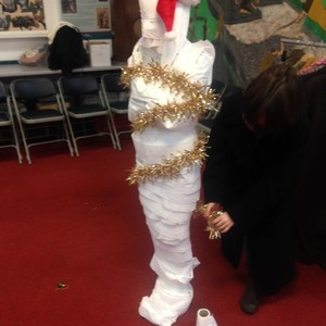 <div class='photo-title'>Christmas wrapping at Glamorgan YAC</div><div class='photo-desc'>All Egyptian mummies wore Father Christmas hats and were wrapped in tinsel. Honest!</div>