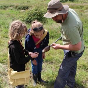 <div class='photo-title'></div><div class='photo-desc'>Checking out the soil sample</div>