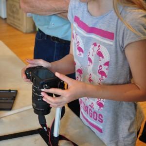<div class='photo-title'></div><div class='photo-desc'>Hannah photographing a Roman coin</div>