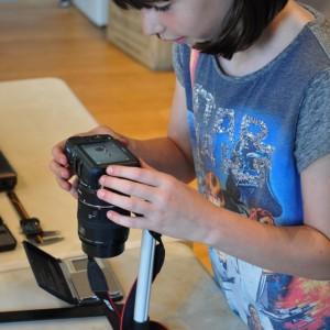 <div class='photo-title'></div><div class='photo-desc'>Gracie photographs a Roman coin</div>