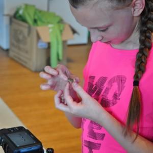<div class='photo-title'></div><div class='photo-desc'>Bethany examines a Roman coin </div>
