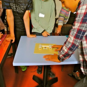 <div class='photo-title'></div><div class='photo-desc'>A YAC member explains his Lego model of a Roman villa to the others.</div>
