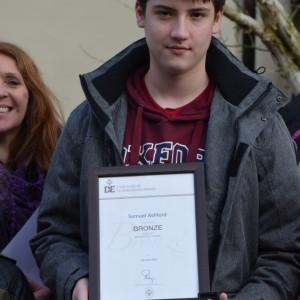 <div class='photo-title'>Congratulations Sam!</div><div class='photo-desc'>Sam with his Bronze Duke of Edinburgh Award</div>